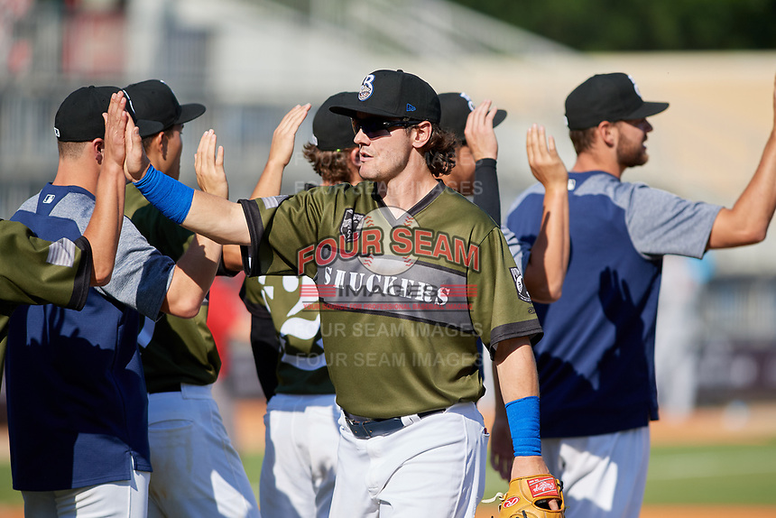 Biloxi Shuckers right fielder Clint Coulter (40) celebrates with his teammates after a game against the Jacksonville Jumbo Shrimp on May 6, 2018 at MGM Park in Biloxi, Mississippi.  Biloxi defeated Jacksonville 6-5.  (Mike Janes/Four Seam Images)