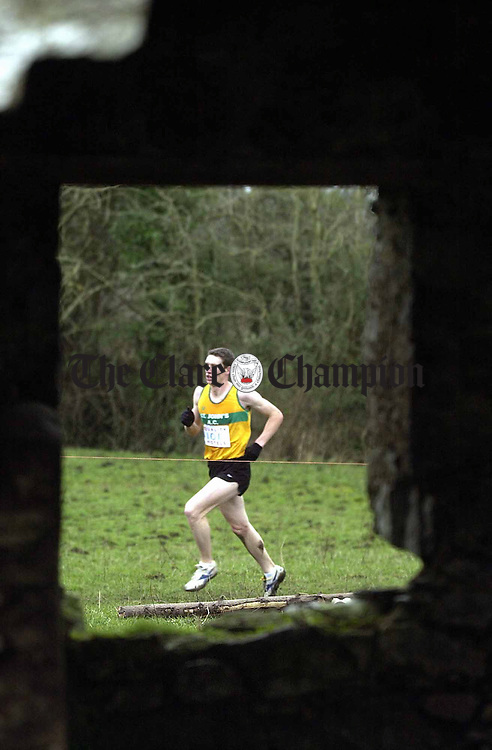 Mens Senior eventual winner Dermot galvin of Kilkee as seen through an old farm building window during the Clare Cross Country Championships in Tulla. Photograph by John Kelly.