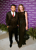 Grammy Award winning artist John Legend, left, and an unidentified guest arrive at the Embassy of the Republic of Macedonia in Washington, D.C. for the Bloomberg News party following the annual White House Correspondents Association (WHCA) dinner on April 29, 2006..Credit: Ron Sachs / CNP.(RESTRICTION: NO New York or New Jersey Newspapers or newspapers within a 75 mile radius of New York City)