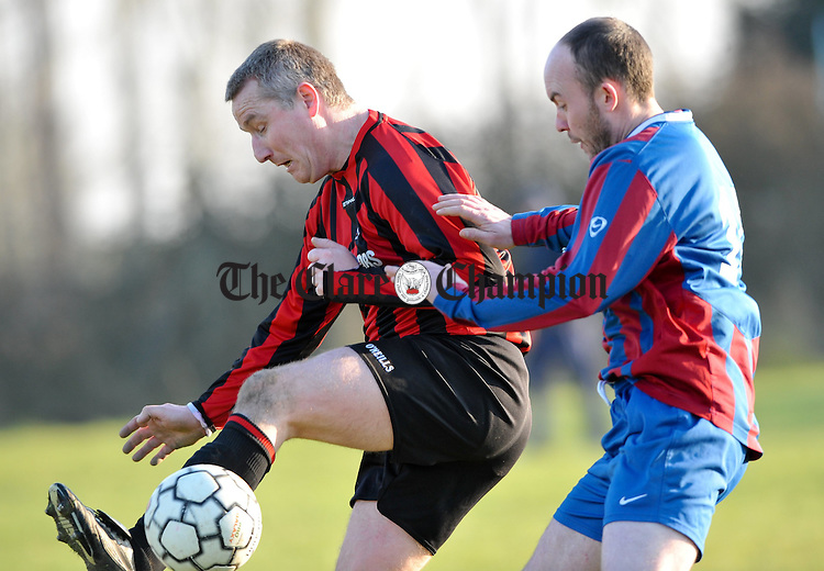 Albert Finnen of Bridge United B in action against George Justice of Shannon Olympic A during their game in Shannon. Photograph by John Kelly.