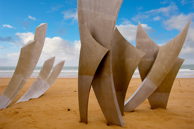 """""""the Brave Men' scupture in the sand at Omaha D Day landing beach, Normandy, France."""