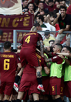 Calcio, Serie A: Roma, stadio Olimpico, 28 maggio 2017.<br /> AS Roma's Daniele De Rossi celebrates after scoring with his teammates during the Italian Serie A football match between AS Roma and Genoa at Rome's Olympic stadium, May 28, 2017.<br /> Francesco Totti's final match with Roma after a 25-season career with his hometown club.<br /> UPDATE IMAGES PRESS/Isabella Bonotto