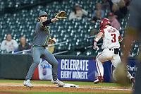 Baylor Bears first baseman Chase Wehsener (37) catches a throw as Zack Gregory (3) of the Arkansas Razorbacks hustles down the line during game nine of the 2020 Shriners Hospitals for Children College Classic at Minute Maid Park on March 1, 2020 in Houston, Texas. The Bears defeated the Razorbacks 3-2. (Brian Westerholt/Four Seam Images)