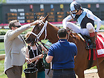 LOUISVILLE, KY - MAY 06: Curalina #1, ridden by John Velazquez, receives congratulations in the winners' circle after winning the La Troienne Stakes on May 6, 2016 in Louisville, Kentucky. (Photo by Sue Kawczynski/Eclipse Sportswire/Getty Images)