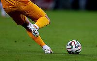 Greece goalkeeper Orestis Karnezis prepares to kick the Adidas Brazuca match ball