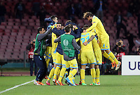 Thursday 27 February 2014<br /> Pictured: Gokhan Inler of Napoli mobbed by team mates celebrating his goal to seal the win with a 3-0<br /> Re: UEFA Europa League, SSC Napoli v Swansea City FC at Stadio San Paolo, Naples, Italy.