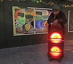 """A man in the Tenderloin district leans on a """"boombox/"""""""