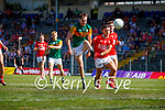 Jack Barry, Kerry, has a shot at goal despite the attention of  Sean Powter, Cork, during the Munster GAA Football Senior Championship Final match between Kerry and Cork at Fitzgerald Stadium in Killarney on Sunday.