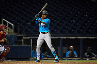 Miami Marlins Monte Harrison (3) bats during a Major League Spring Training game against the Washington Nationals on March 20, 2021 at FITTEAM Ballpark of the Palm Beaches in Palm Beach, Florida.  (Mike Janes/Four Seam Images)