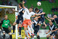 MELBOURNE, AUSTRALIA - DECEMBER 03: Kosta Barbarouses of the Roar heads the ball during the round 17 A-League match between the Melbourne Victory and the Brisbane Roar at AAMI Park on December 3, 2010 in Melbourne, Australia. (Photo by Sydney Low / Asterisk Images)