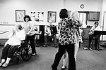 CHAD PILSTER •Hays Daily News<br /> <br /> Darlene Herrick, left, resident, is pushed by Ruan Windholz, Wes Windholz's wife, and Treva Benoit, the director, and Bea Seba, a resident, all dance while Wes Windholz, on the accordion, and Rosie Dinkel, on saxophone, play polka music on Thursday, October 17, 2013 by the Wes Windholz Band at the Cedar View Assisted Living Residence in Hays, Kansas. The Wes Windholz Band plays the third Thursday of every month at area retirement homes.