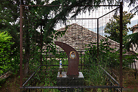 Albania. Gjirokastër. Old town. A granite crescent shape for a memorial of a dead young muslim man. Mental cage. A plastic bottle of water. Gjirokastër is a city in southern Albania. 23.05.2018