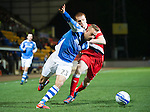 St Johnstone v Ross County...17.11.12      SPL.Rowan Vine is fouled by Scott Boyd.Picture by Graeme Hart..Copyright Perthshire Picture Agency.Tel: 01738 623350  Mobile: 07990 594431