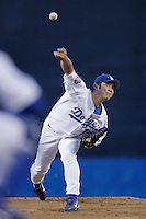 Hideo Nomo of the Los Angeles Dodgers pitches during a 2002 MLB season game at Dodger Stadium, in Los Angeles, California. (Larry Goren/Four Seam Images)
