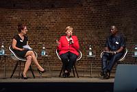 """Veranstaltung """"50 Jahre Entwicklungshelfer-Gesetz – 'Die Welt im Gepaeck'"""" am Freitag den 12. Juli 2019 in der Berliner St. Elisabethkirche.<br /> Als Gast war die Bundeskanzlerin Angela Merkel geladen.<br /> Den Ehrentag fuer zurueckgekehrte Entwicklungshilfe-Fachkraefte veranstalten die Gemeinsame Konferenz Kirche und Entwicklung (GKKE) und die Arbeitsgemeinschaft der Entwicklungsdienste (AGdD).<br /> Im Bild: Eine Gespraechsrunde mit Entwicklungshelfern. Vlnr.: Friedericke Repnik, Moderatorin; Bundeskanzlerin Angela Merkel; Dr. Sheku Kamara, Direktor des Conservation Society of Sierra Leone.<br /> 12.7.2019, Berlin<br /> Copyright: Christian-Ditsch.de<br /> [Inhaltsveraendernde Manipulation des Fotos nur nach ausdruecklicher Genehmigung des Fotografen. Vereinbarungen ueber Abtretung von Persoenlichkeitsrechten/Model Release der abgebildeten Person/Personen liegen nicht vor. NO MODEL RELEASE! Nur fuer Redaktionelle Zwecke. Don't publish without copyright Christian-Ditsch.de, Veroeffentlichung nur mit Fotografennennung, sowie gegen Honorar, MwSt. und Beleg. Konto: I N G - D i B a, IBAN DE58500105175400192269, BIC INGDDEFFXXX, Kontakt: post@christian-ditsch.de<br /> Bei der Bearbeitung der Dateiinformationen darf die Urheberkennzeichnung in den EXIF- und  IPTC-Daten nicht entfernt werden, diese sind in digitalen Medien nach §95c UrhG rechtlich geschuetzt. Der Urhebervermerk wird gemaess §13 UrhG verlangt.]"""