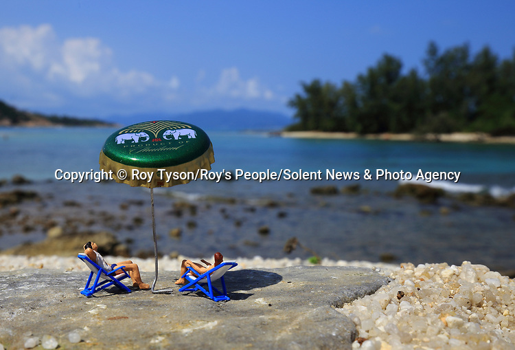 Pictured: Living the dream<br /> <br /> Tiny figurines give a new perspective on everyday objects as they are posed interacting with them in their miniature world.  Artist Roy Tyson creates witty and intriguing imagery with customised miniature figures, under the name Roy's People.<br /> <br /> Since 2012, he has been photographing his miniature world on the streets of London and beyond.  SEE OUR COPY FOR DETAILS.<br /> <br /> Please byline: Roy Tyson/Roy's People/Solent News<br /> <br /> © Roy Tyson/Roy's People/Solent News & Photo Agency<br /> UK +44 (0) 2380 458800