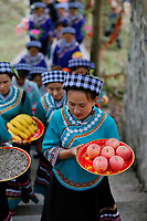 Women of the ethnic Bouyei Tribe carry offerings to a shrine to celebrate the Lunar March 3rd Festival at Wangmo County in China's southwestern Guizhou Province, April 2019.
