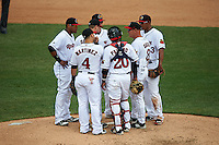 Rochester Red Wings manager Mike Quade (8) talks with pitcher Pat Dean (21) as (L-R) Argenis Diaz (13), Jose Martinez (4), James Beresford (2 - back), Carlos Paulino (20) and Reynaldo Rodriguez (23) listen in during a game against the Pawtucket Red Sox on July 1, 2015 at Frontier Field in Rochester, New York.  Rochester defeated Pawtucket 8-4.  (Mike Janes/Four Seam Images)