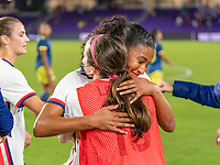 ORLANDO, FL - JANUARY 22: Margaret Purce #23 and Rose Lavelle #16 of the USWNT hug after a game between Colombia and USWNT at Exploria stadium on January 22, 2021 in Orlando, Florida.