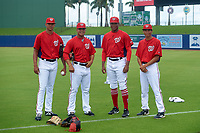 GCL Nationals (L-R) Felix Taveras, Jairon Peguero, Wilson Severino, and Michael Cuevas before a Gulf Coast League game against the GCL Mets on August 12, 2019 at FITTEAM Ballpark of the Palm Beaches in Palm Beach, Florida.  GCL Nationals defeated the GCL Mets 7-3.  (Mike Janes/Four Seam Images)