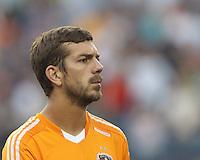 Houston Dynamo defender Eric Brunner (2). In a Major League Soccer (MLS) match, Houston Dynamo (orange) defeated the New England Revolution (blue), 2-1, at Gillette Stadium on July 13, 2013.