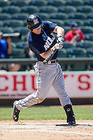 New Orleans Zephyrs third baseman Mark Canha #21 swings the bat during the Pacific Coast League baseball game against the Round Rock Express on May 4, 2014 at the Dell Diamond in Round Rock, Texas. The Express defeated the Zephyrs 15-12. (Andrew Woolley/Four Seam Images)