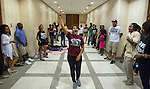 TALLAHASSEE, FL - AUGUST 5, 2013:   Annie Thomas, from Miami, leads the Dream Defenders in a rally outside the governor's office in the lobby of the Florida State Capitol.  The Dream Defenders have been occupying the governors office and the state capitol 24 hours a day for 21 consecutive days protesting Florida's Stand Your Ground law.  <br /> (CREDIT: Mark Wallheiser for Getty Images)<br /> ©2013 Mark Wallheiser