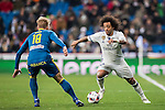 Marcelo Vieira Da Silva (r) of Real Madrid fights for the ball with Daniel Wass of RC Celta de Vigo during their Copa del Rey 2016-17 Quarter-final match between Real Madrid and Celta de Vigo at the Santiago Bernabéu Stadium on 18 January 2017 in Madrid, Spain. Photo by Diego Gonzalez Souto / Power Sport Images