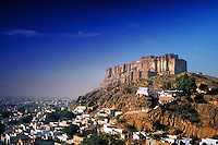 Panoramic view of fort on mountain top, India. Cityscape below. fortress, military architecture. India Asia.