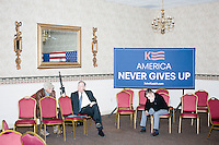 A campaign worker (at right) sits down after Republican presidential candidate and Ohio governor John Kasich spoke at a townhall campaign event at Bektash Shrine Temple in Concord, New Hampshire.