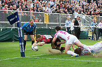 20120823 Copyright onEdition 2012©.Free for editorial use image, please credit: onEdition..Chris Ashton of Saracens dives for the line despite the tackle of Yannick N'Gog of Stade Francais Paris at The Honourable Artillery Company, London in the pre-season friendly between Saracens and Stade Francais Paris...For press contacts contact: Sam Feasey at brandRapport on M: +44 (0)7717 757114 E: SFeasey@brand-rapport.com..If you require a higher resolution image or you have any other onEdition photographic enquiries, please contact onEdition on 0845 900 2 900 or email info@onEdition.com.This image is copyright the onEdition 2012©..This image has been supplied by onEdition and must be credited onEdition. The author is asserting his full Moral rights in relation to the publication of this image. Rights for onward transmission of any image or file is not granted or implied. Changing or deleting Copyright information is illegal as specified in the Copyright, Design and Patents Act 1988. If you are in any way unsure of your right to publish this image please contact onEdition on 0845 900 2 900 or email info@onEdition.com