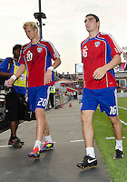 FC Dallas defender/midfielder Brek Shea #20 and FC Dallas defender Bobby Warshaw #16 walk off the pitch after warm-ups during an MLS game between the FC Dallas and the Toronto FC at BMO Field in Toronto on July 20, 2011..FC Dallas won 1-0.