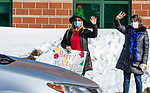 WATERTOWN, CT-122320JS02- Kindergarten teacher Monica Quadrato and Paraprofessional Amy DosSantos wave to their students at John Trumbull Primary School in Watertown on Wednesday as teachers and staff say farewell to students for the winter break even though schools have been online for weeks. <br /> Jim Shannon Republican-American