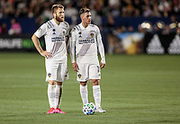 CARSON, CA - MARCH 07: Aleksander Katai #7 and Cristian Pavon #10 of the Los Angeles Galaxy contemplate who will kick during a game between Vancouver Whitecaps and Los Angeles Galaxy at Dignity Health Sports Park on March 07, 2020 in Carson, California.