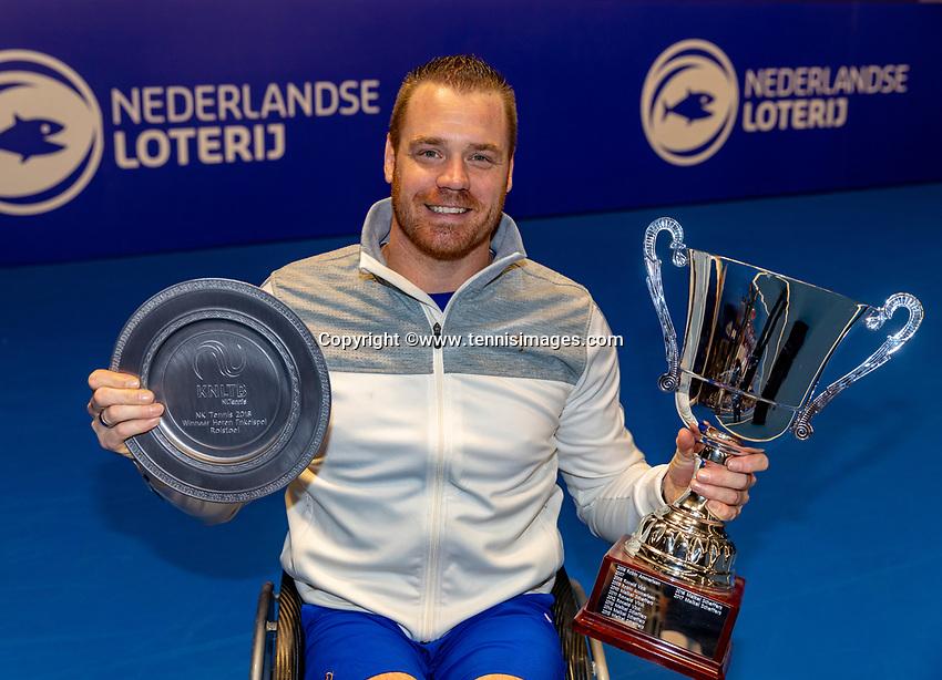 Alphen aan den Rijn, Netherlands, December 16, 2018, Tennispark Nieuwe Sloot, Ned. Loterij NK Tennis, Final  Whelchair men: Maikel Scheffers (NED) winner with the trophy<br /> Photo: Tennisimages/Henk Koster