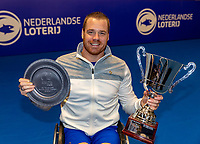 Alphen aan den Rijn, Netherlands, December 16, 2018, Tennispark Nieuwe Sloot, Ned. Loterij NK Tennis, Final  Whelchair men: Maikel Scheffers (NED) winner with the trophy<br /> Photo: Tennisimages/Henk Koster