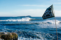 A Bad Billys Billabong flag flying over the line up of Mundaka river-mouth during an epic swell in November 1989. Mundaka, Basque Country, Spain. Photo: joliphotos.com