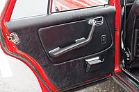 The rear door card of the Mercedes W123 series 230TE estate version, outside the Penderyn Whisky Distillery in south Wales, UK. Tuesday 19 June 2018