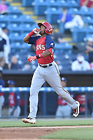 Hagerstown Suns third baseman Kelvin Gutierrez (5) gives thanks after hitting a home run during a game against the Asheville Tourists at McCormick Field on June 8, 2016 in Asheville, North Carolina. The Tourists defeated the Suns 10-8. (Tony Farlow/Four Seam Images)