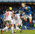 Kenny Miller and Jon Toral attack the ball