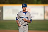Stockton Ports infielder Luke Persico (3) coaches first base during a California League game against the Visalia Rawhide at Visalia Recreation Ballpark on May 8, 2018 in Visalia, California. Stockton defeated Visalia 6-2. (Zachary Lucy/Four Seam Images)