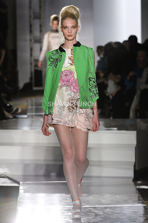 Model walks runway in an outfit by Snehal Bathwal, for the Parsons 2011 BFA Fashion Show, hosted by Reed Krakoff.