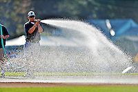 30 June 2012: Vermont Lake Monsters Grounds Crew waters down the infield prior to a game against the Lowell Spinners at Centennial Field in Burlington, Vermont. Mandatory Credit: Ed Wolfstein Photo