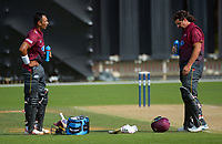 Jeet Raval and Colin de Grandhomme during the Ford Trophy men's cricket match between Wellington Firebirds and Northern Districts at the Basin Reserve in Wellington, New Zealand on Sunday, 21 February 2021. Photo: Dave Lintott / lintottphoto.co.nz