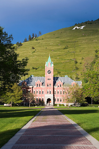 Main Hall on the University of Montana campus in Missoula, Montana. The M and Mount Sentinel in the sunlit background