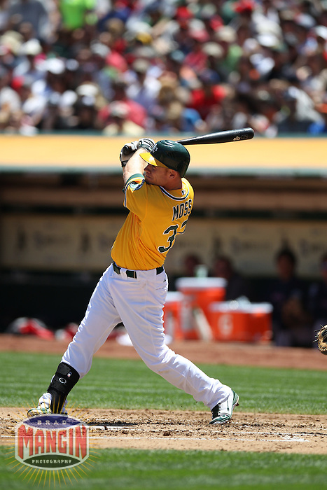 OAKLAND, CA - JULY 4:  Brandon Moss #37 of the Oakland Athletics hits a home run against the Boston Red Sox during the game at O.co Coliseum on Saturday, July 4, 2012 in Oakland, California. Photo by Brad Mangin