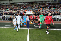 SWANSEA, WALES - FEBRUARY 21: Team captains Ashley Williams of Swansea and Wayne Rooney of Manchester leads their teams out of the tunnel prior to the Barclays Premier League match between Swansea City and Manchester United at Liberty Stadium on February 21, 2015 in Swansea, Wales.