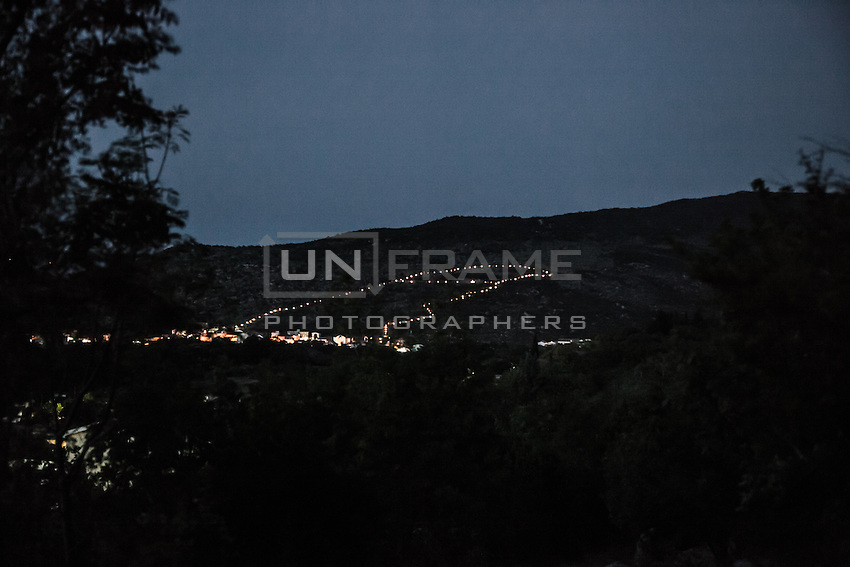 The Via Crucis on Podbro hill at night, view from the Mt. Krizevac.<br /> Medjugorje, Bosnia and Herzegovina. July 2012