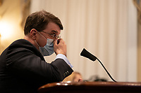 United States Secretary of Veterans Affairs (VA) Robert Wilkie, adjusts his face mask while speaking at a hearing with the US House Appropriations Subcommittee on Military Construction, Veterans Affairs, and Related Agencies on Capitol Hill in Washington DC, on May 28th, 2020.<br /> Credit: Anna Moneymaker / Pool via CNP/AdMedia