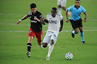 WASHINGTON, DC - AUGUST 25: Cristian Penilla #70 of New England Revolution battles for the ball with Junior Moreno #5 of D.C. United during a game between New England Revolution and D.C. United at Audi Field on August 25, 2020 in Washington, DC.